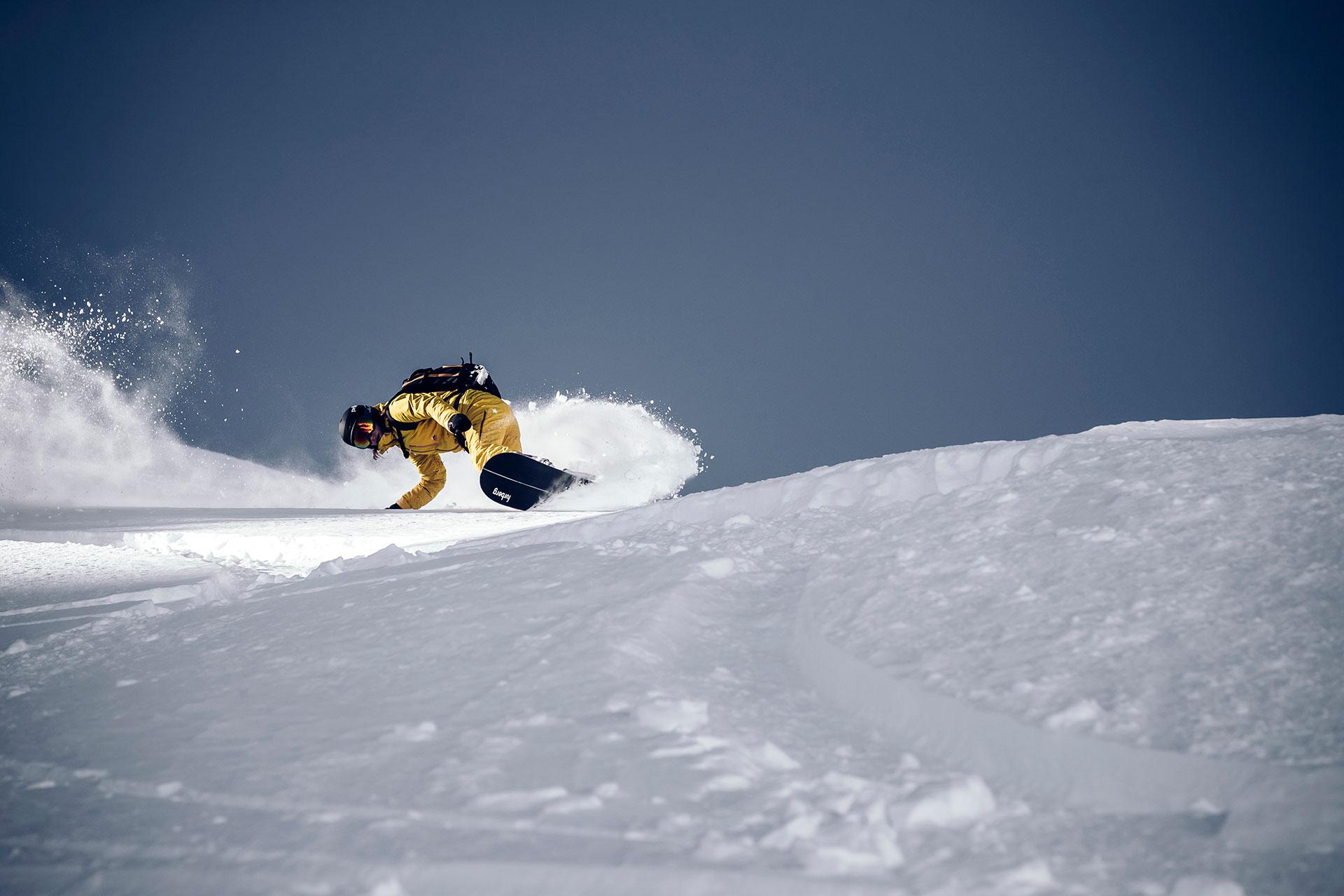 Snowboard Fotograf Aktion Freeride Powder Tiefschnee Zürich Schweiz Ski Outdoor